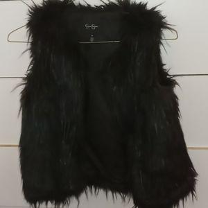A black furry vest